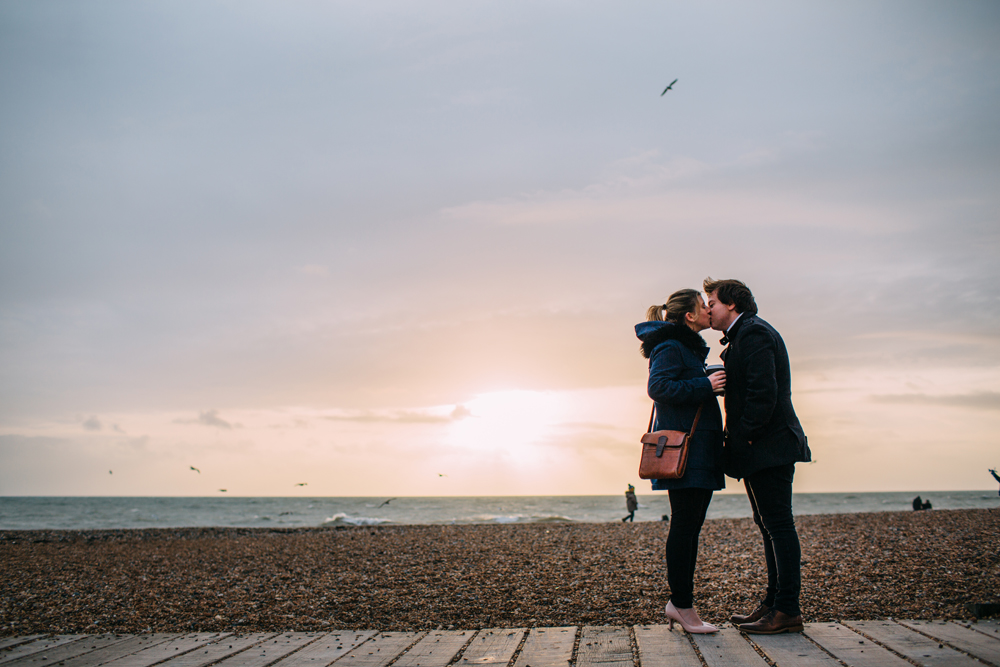 kissing on Brighton beach at sunset