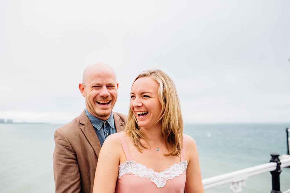 Couple Laughing on Brighton Pier