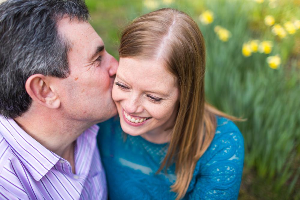 Couple Kissing at Gravetye Manor Engagement Shoot