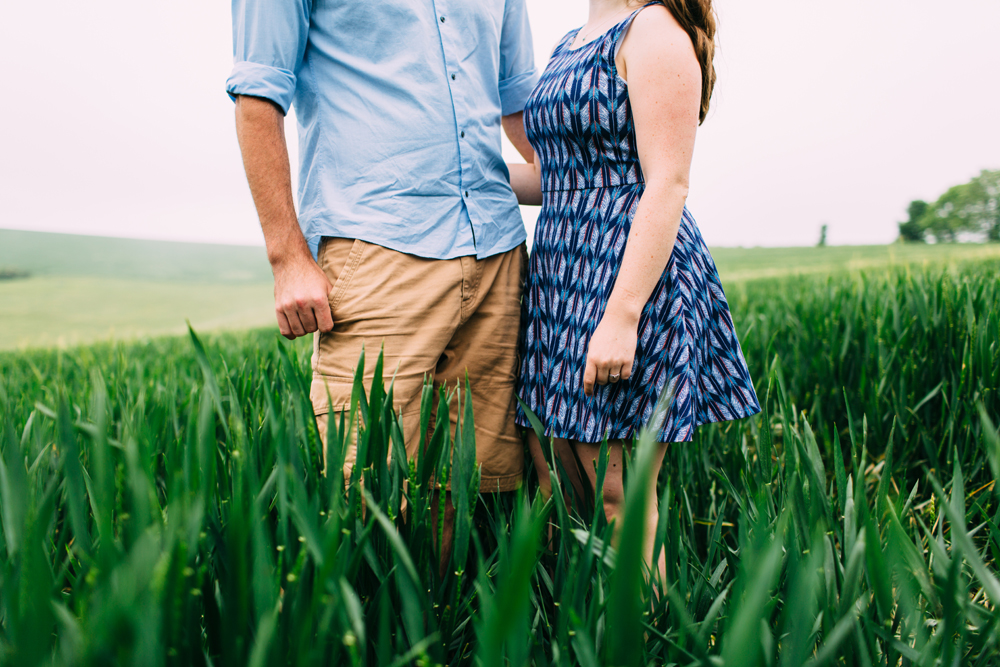 Couple in Field for Sussex Countryside Engagement Shoot