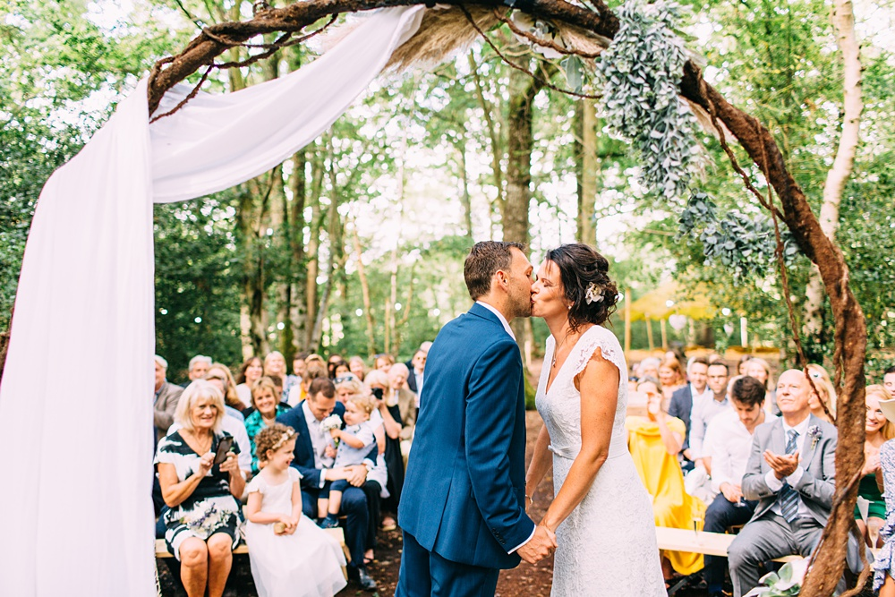 first kiss in sussex woodland wedding